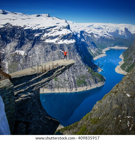 Amazing Famous Norway Trolltunga view point at morning with snow at the top of mountain