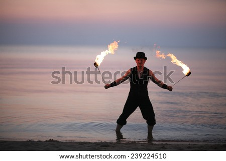 Amazing fire show on the beach  - stock photo