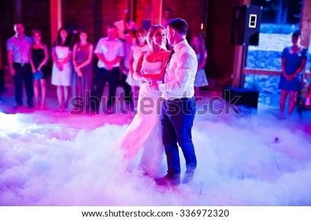 Amazing first wedding dance on heavy smoke  - stock photo