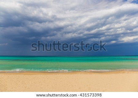 Amazing golden sand beach near Monopolli Capitolo, amazing atmosphere during stormy day, Apulia region, Southern Italy