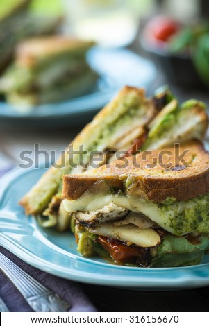 Amazing grilled chicken cheese and pesto sandwich - stock photo
