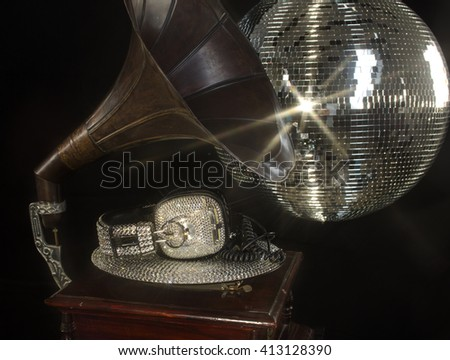 amazing handmade bling crystal covered headphones on a crystal record and vintage gramophone