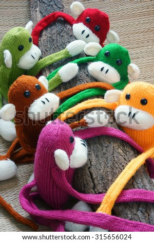 Amazing handmade product, group of colorful homemade monkey with funny humorous , knitted monkeys, knit from wool, woolen toy to happy new year, fun animal