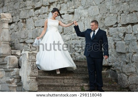 Amazing happy gentle stylish beautiful romantic caucasian couple on the background ancient baroque castle, Lviv