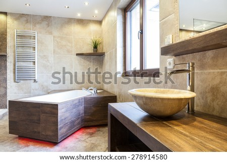 Amazing interior of the bathroom in a fashionable apartment - stock photo
