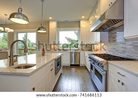 Amazing Kitchen Design With White Shaker Cabinets Paired With Gray Marble  Counters, Large Kitchen Peninsula