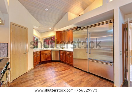 amazing kitchen with high end stainless steel appliances high vaulted ceiling and oak wood amazing kitchen highend stainless steel appliances stock photo      rh   shutterstock com
