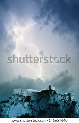 amazing lightning over the castle on the rope - stock photo