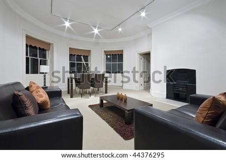 amazing living room with massive bay window - stock photo