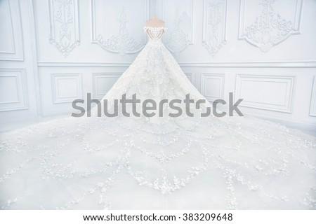 Amazing long wedding dress on a mannequin. - stock photo