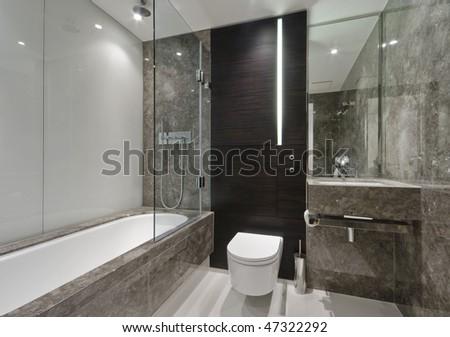 amazing luxury bathroom with brown marble finish - stock photo