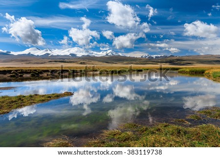 Amazing mountain landscape with river and clouds. Plateau Ukok, Altai - stock photo