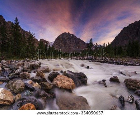 Amazing mountain landscape with trees and a river.