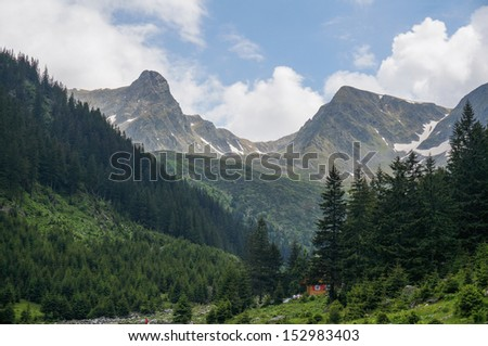 Amazing mountain scenery with small hidden hut, in summer season. Location: Fagaras Mountains, Romania