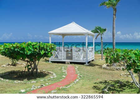 amazing, natural landscape view with beautiful inviting gorgeous massage gazebo near the beach and ocean  on sunny warm day - stock photo