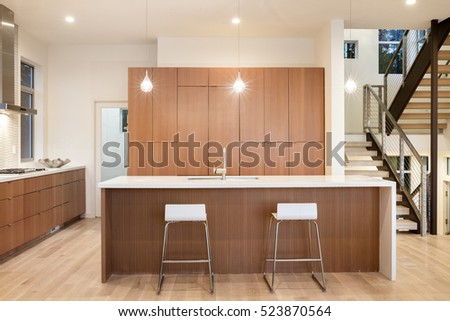 https://thumb1.shutterstock.com/display_pic_with_logo/161865248/523870564/stock-photo-amazing-new-contemporary-wooden-kitchen-with-kitchen-island-and-bar-chairs-523870564.jpg
