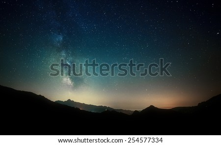 amazing night sky stars panorama with milky way on mountain background - stock photo