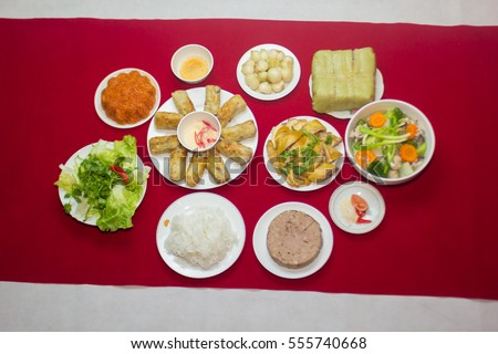Amazing of Vietnamese food for Tet holiday in spring, it is traditional food on lunar new year: Banh chung, Boiled chicken, pickled onions, spring rolls ...