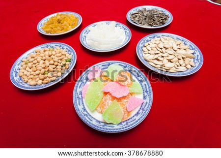 Amazing of Vietnamese food for Tet holiday in spring, jam is traditional food on lunar new year, make from sweet potato, lotus seed, ginger, mango with sugar, colorful background for Vietnam culture