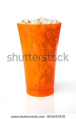 Amazing orange glass of popcorn isolated on a white background