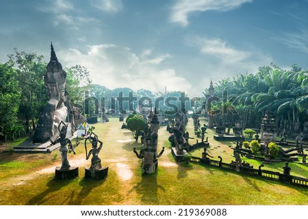 Amazing panorama view of mythology and religious statues at Wat Xieng Khuan Buddha park. Vientiane, Laos - stock photo