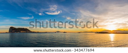 Amazing panoramic view on the rock of Gibraltar during sunset and the ships around it. - stock photo