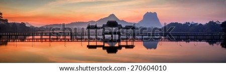 Amazing park landscape panorama at sunrise. Bridge and pavilion on lake at Hpa-An, Myanmar (Burma) travel landscapes and destinations. Five images panorama - stock photo