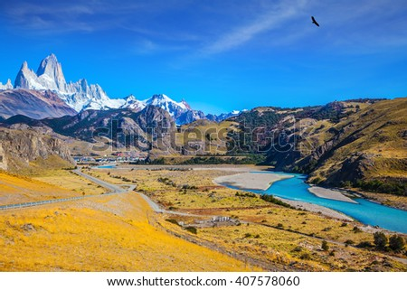 Amazing Patagonia. The white top of Fitzroy rocks covered the midday sun. The drying-up river in the valley of town of El Chalten - stock photo