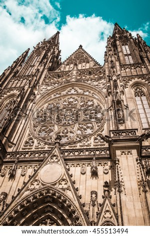 Amazing portal of famous gothic St. Vitus Cathedral against teal blue cloudy sky (Czech: Chram Svateho Vita, Prazsky Hrad), Prague Castle complex, seat of Archbishop of Prague, UNESCO protected site - stock photo