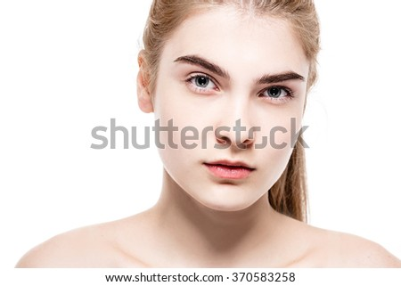 Amazing portrait of a beautiful young woman blond hair with perfect skin closeup - stock photo