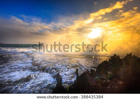 Amazing power of waves crashing against the rocks at dawn - stock photo
