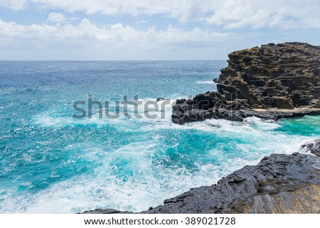 Amazing power of waves crashing against the rocks by the coasts of the island. - stock photo
