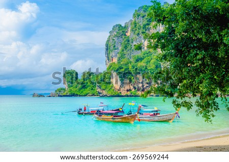 Amazing Railay Beach with mogotes, long tail boat and high palm trees, Krabi, Thailand