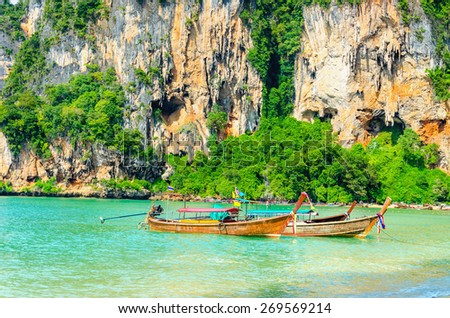 Amazing Railay Beach with mogotes, long tail boat andred kayaks, Krabi, Thailand - stock photo