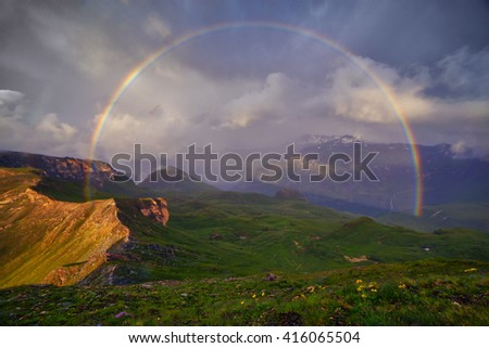 Amazing rainbow on the top of grossglockner pass, Alps, Switzerland, Europe. - stock photo