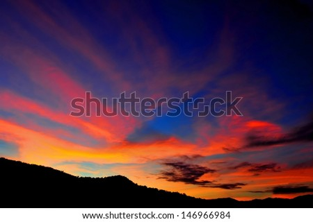 amazing red and orange hues of sunset, cooktown, queensland, australia - stock photo