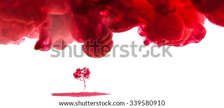 Amazing red inky cloud in water isolated on white