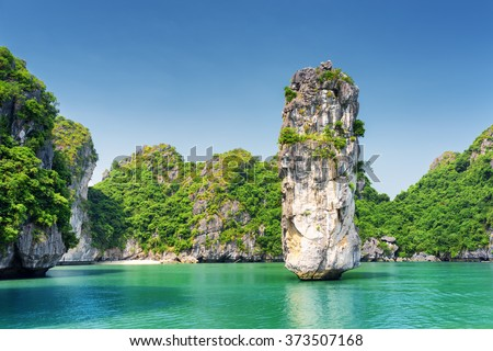 Amazing rock pillar and azure water in the Ha Long Bay (Descending Dragon Bay) at the Gulf of Tonkin of the South China Sea, Vietnam. The Halong Bay is a popular tourist destination of Asia. - stock photo