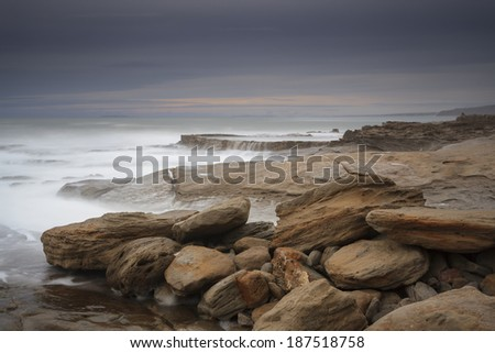 Amazing scenery on the coast of Portugal. Fine art photography in a long exposure in a dramatic setting storm. - stock photo