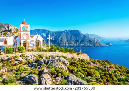 Amazing sea bay on Greek Island with Greek white church - stock photo