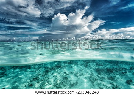 Amazing seascape, dramatic cloudy sky, coral gardens under beautiful transparent water, beauty of nature, summer time concept  - stock photo