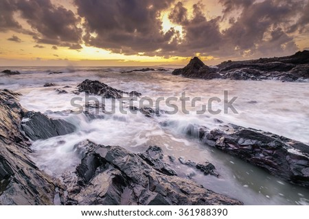 Amazing seascape during sunset with slow shutter technique - stock photo