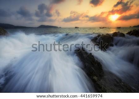 Amazing seascape during sunset with slow shutter technique  at Kalim Beach, Phuket Thailand. - stock photo