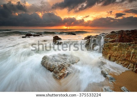 Amazing seascape sunrise at Kemasik Beach, Terengganu. Nature composition. - stock photo