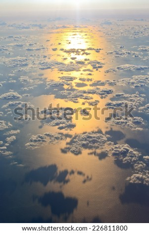Amazing skyscape over the ocean at sunrise. With many single clouds above ocean water.  - stock photo