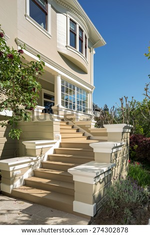 Amazing staircase leading to grant entry, porch of Classical American private home, mansion.  - stock photo