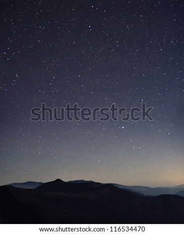 Amazing Star Night and cloudy mountains panorama - stock photo