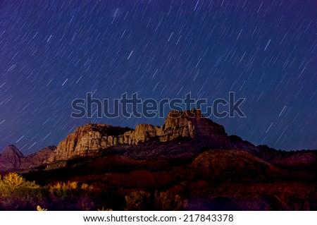 amazing stars night landscape over zion national park - stock photo