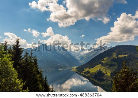 Amazing summer morning on the fantastic Speicher Durlassboden lake. Alps, Austria, Europe.