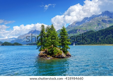 Amazing sunny day at Silsersee lake in the Swiss Alps. Segl, Switzerland, Europe. - stock photo